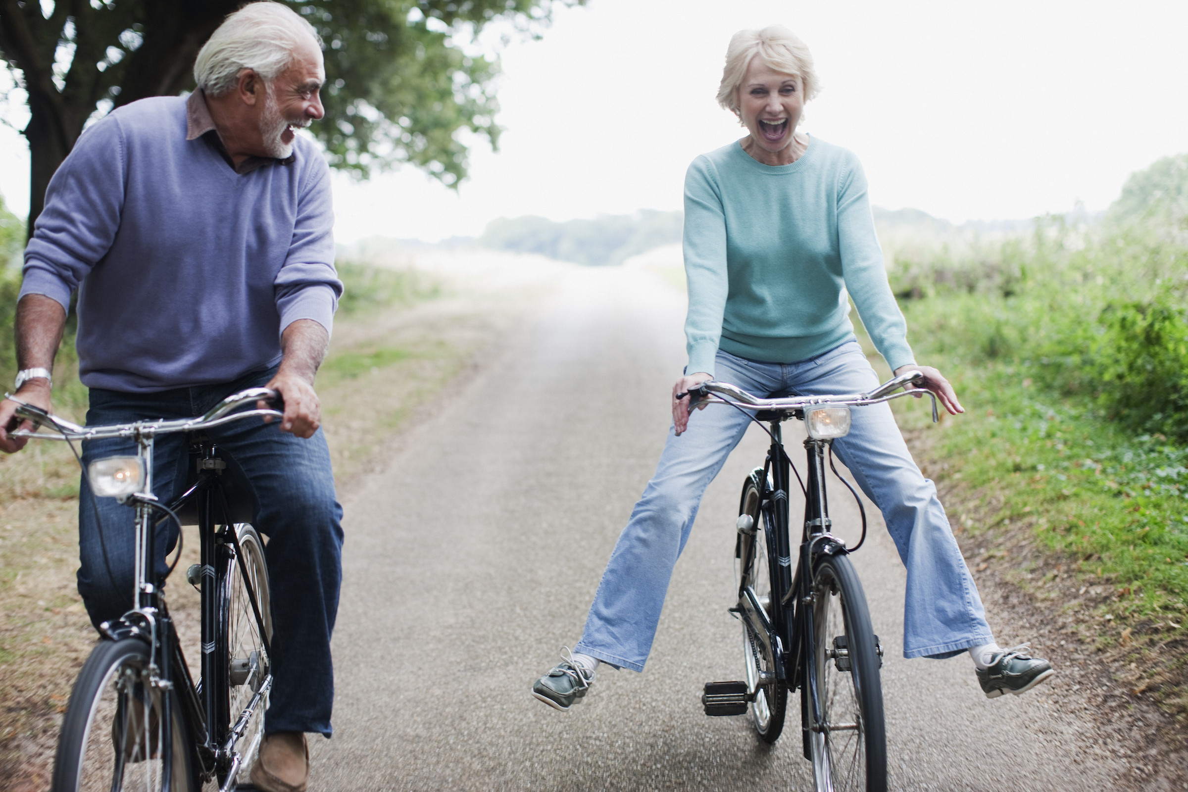 Man and woman riding bicycles